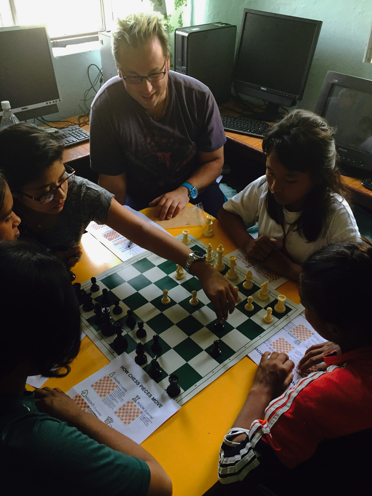 George,Australia playing chess with safehouse children
